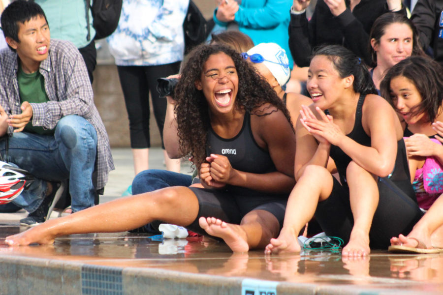 Varsity Swimmer Morgan Hawes (left) screams with joy after realizing Carlmont swept all PALs championship titles for a second year in a row.
