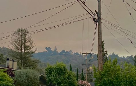 Smoke clouds the Bay Area skies on Tuesday afternoon, the smell infiltrating homes and leaving many residents worried.