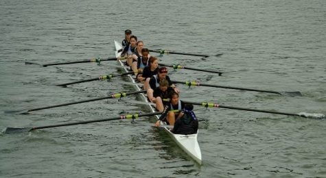 Marrisa Chow, a sophomore, and her teammates row in a regatta.