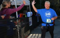 Local Belmont resident Fred Ehlers celebrates finishing his run.