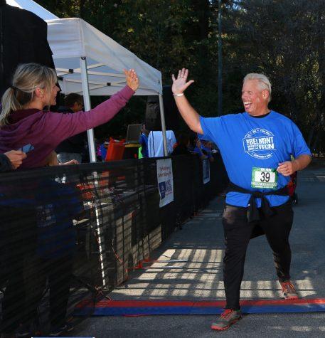 Local Belmont resident Fred Ehlers celebrates finishing his run.