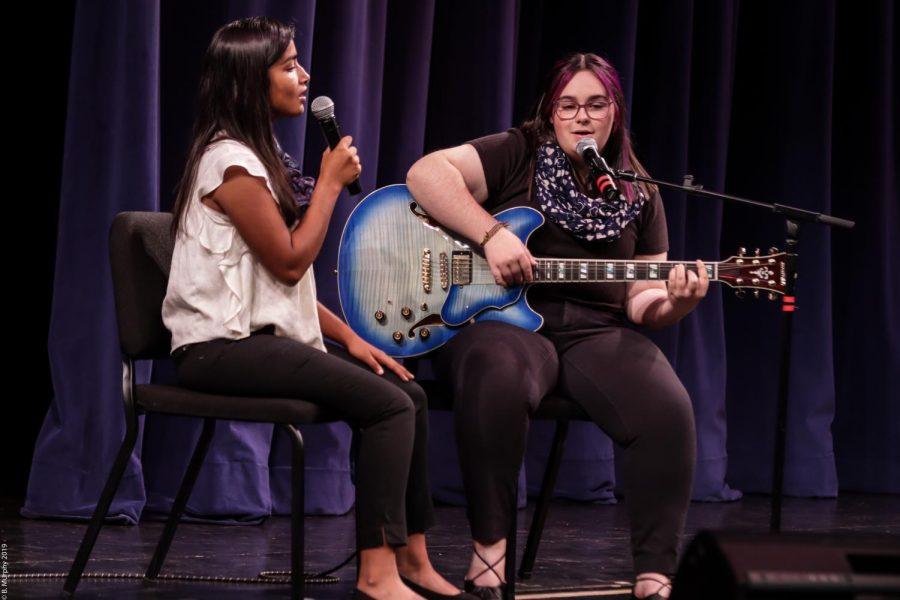 Dani Courtney performs on stage, before the pandemic, alongside Keya Arora.