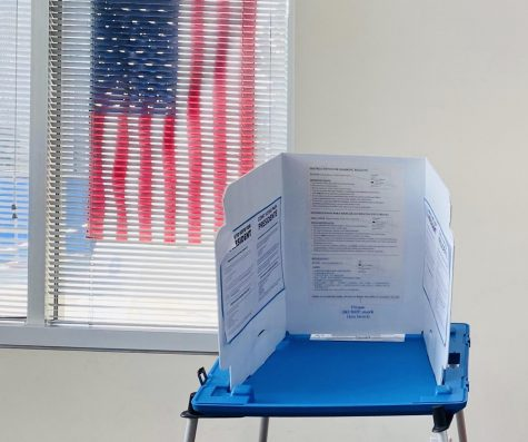 A voting station stands alone in the Redwood City Assessor/County Clerk Office.