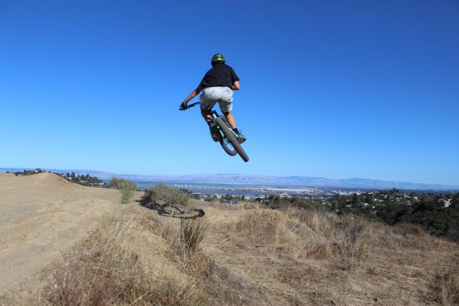 Eric Chuang, a junior, does a table over a large jump.
