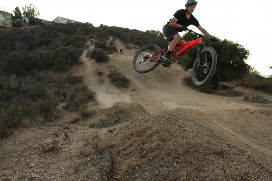 Eric Chuang, Junior, throws his bike sideways in a whip.