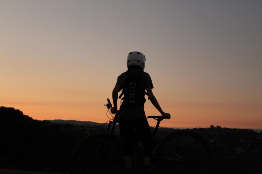 Kenzo Peraire, Sophomore, looks out at the sunset after a long day of riding.