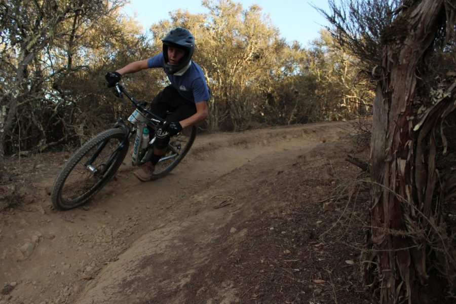 Carl Bussiek, a sophomore, rides a berm on the Rambler Trail.
