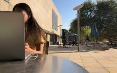 A freshman at the University of California, Berkeley studies for her classes in front of the Berkeley Law School.