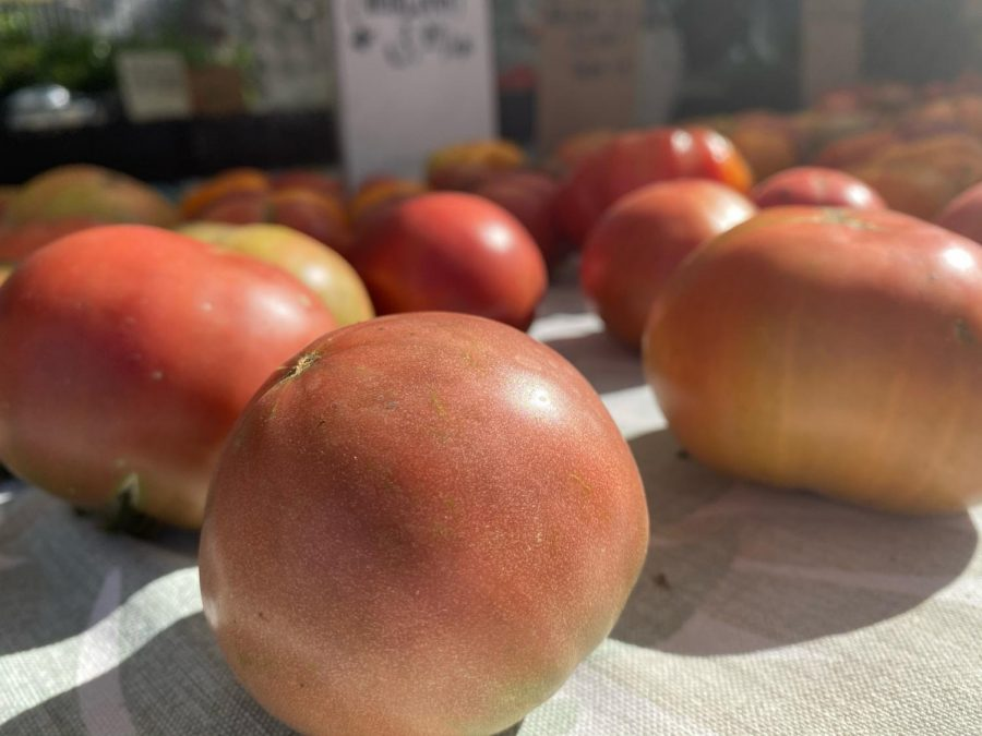 The farmers' market reopens for the community to enjoy local produce, flowers, and more.