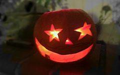 Dan Teng celebrates Halloween by setting a carved pumpkin in his backyard.
