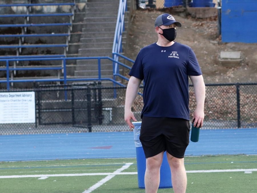 Eric Rado, who was promoted to head coach of varsity football ahead of the 2020 season, directs a pod through conditioning exercises.