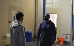 Sophomore football player Arman Agarwal talks with head coach Eric Rado about his progress throughout the season.