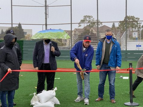 Belmont Mayor Warren Lieberman cuts the ribbon to the newly renovated North Field.