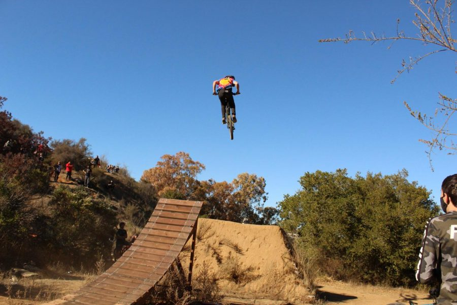 A local rider boosts high on