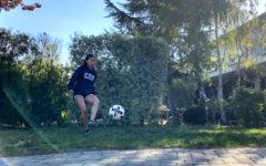 Ella Yee, a sophomore, sports her Scots gear in an at-home practice as she prepares for the upcoming school season.