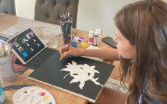 Savannah Meadow, a junior at Design Tech High School, takes a virtual art class.