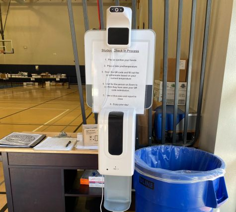 "Once someone enters the Scots Gym, the hand sanitizing station and a list of directions and procedures await them.  ""When students get to the check-in station … [they] fill out a questionnaire … then they take their temperature and sanitize their hands,"" said health aide Samantha Gingher, adding that students can"