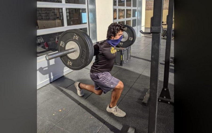 John Paul Avila, a senior, performs a reverse lunge with 185 pounds.