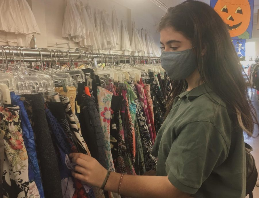 Natalie Tobias, a sophomore at Carlmont High School, looks through the various clothing racks at Thrift Center, a thrift store in San Carlos, California. She began shopping more at thrift stores after they reopened in July.