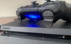The PS4 controller lights up, indicating a player is ready to begin gaming.