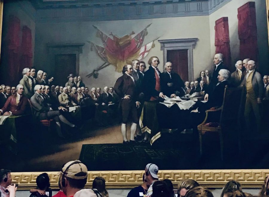 Visitors at the capitol building observe a painting of the Constitutional Convention, where the Founding Fathers used negotiations to form our nation.