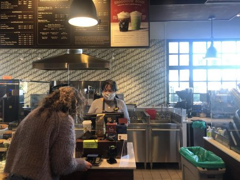 """Guillermina Castellanos purchases a drink at Peet's Coffee in Belmont using her credit card. """"I prefer paying with a contactless credit card, especially during the pandemic because it"""