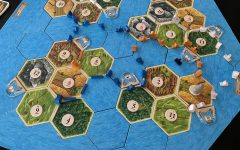 Catan Seafarers lets players build beyond Catan onto the islands that around it. This is a finished game of the Four  Islands Scenario, one of nine scenarios included in the game's rulebook.