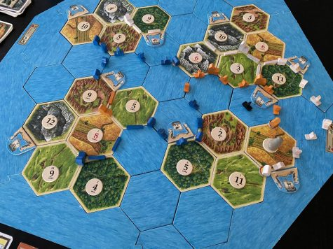 Catan Seafarers lets players build beyond Catan onto the islands that are around it. This is a finished game of the Four Islands Scenario, one of nine scenarios included in the rulebook.