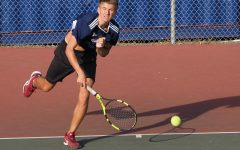 Daniel Generalov, a sophomore on the boys tennis team, plays in a singles match against Hillsdale during the short-lived 2020 season.