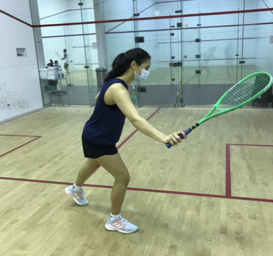 Aanika+Tiwary+raises+her+racket+as+she+prepares+to+swing+and+hit+the+ball+against+the+wall.