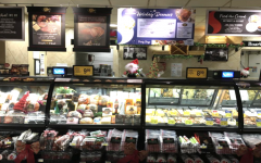 A Safeway in Belmont, CA displays various meat and dairy products along with their according prices.