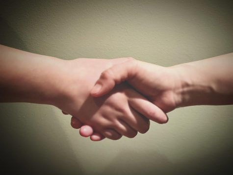A handshake is often recognized as a symbol of forgiveness.