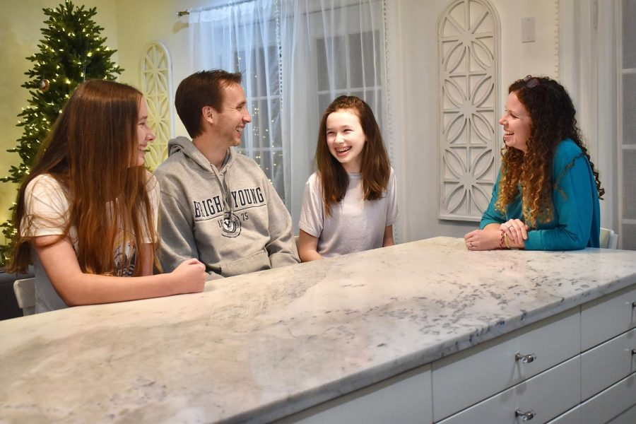 Parents and teens can get along in various ways. Sadie North, a senior, spends time with her parents and younger sister.