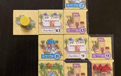 Alhambra is an easy-to-learn game for two to six players that involves collecting money cards and using them to build tiles in an Alhambra. An example of a partially built Alhambra is shown here.