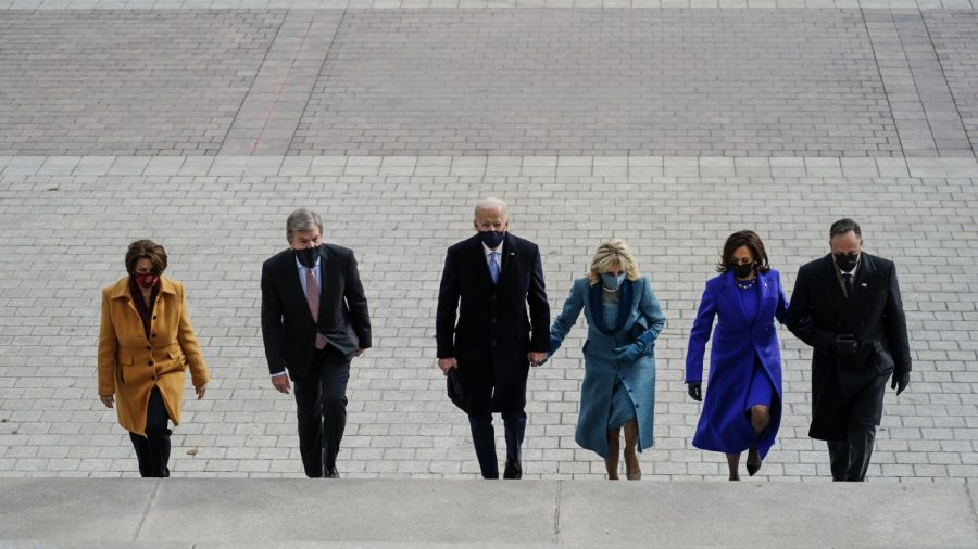 President Biden, first lady Jill Biden, Vice President Harris and second gentleman Doug Emhoff walk up the steps of the U.S. Capitol prior to the inauguration.