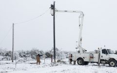 Electricians in Texas work to fix a power line to deliver power to residents.