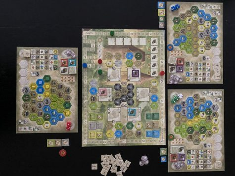 In the Castles of Burgundy, players take tiles from the main board and place them on the matching colored spaces on their player board to score the most points. The game is designed by Stefan Feld and published by Ravensburger Games.