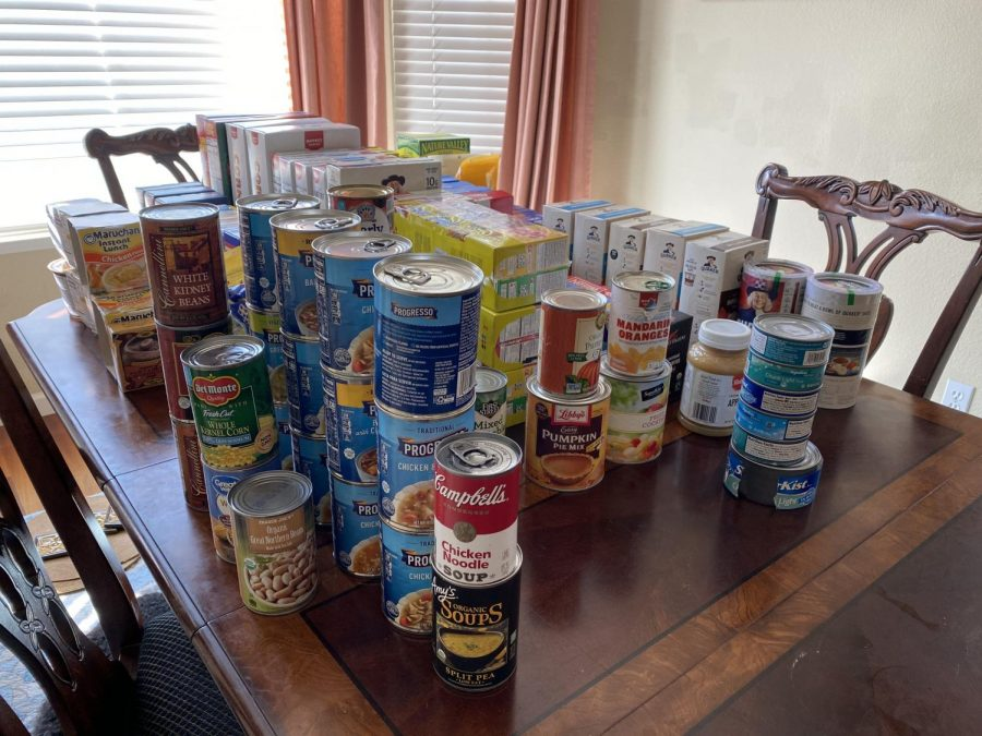 The OneWorld Club is donating contributions from their breakfast food drive to the Samaritan House.