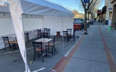 In San Carlos, parts of streets are being taken up by tables and chairs to provide outdoor dining for restaurants.