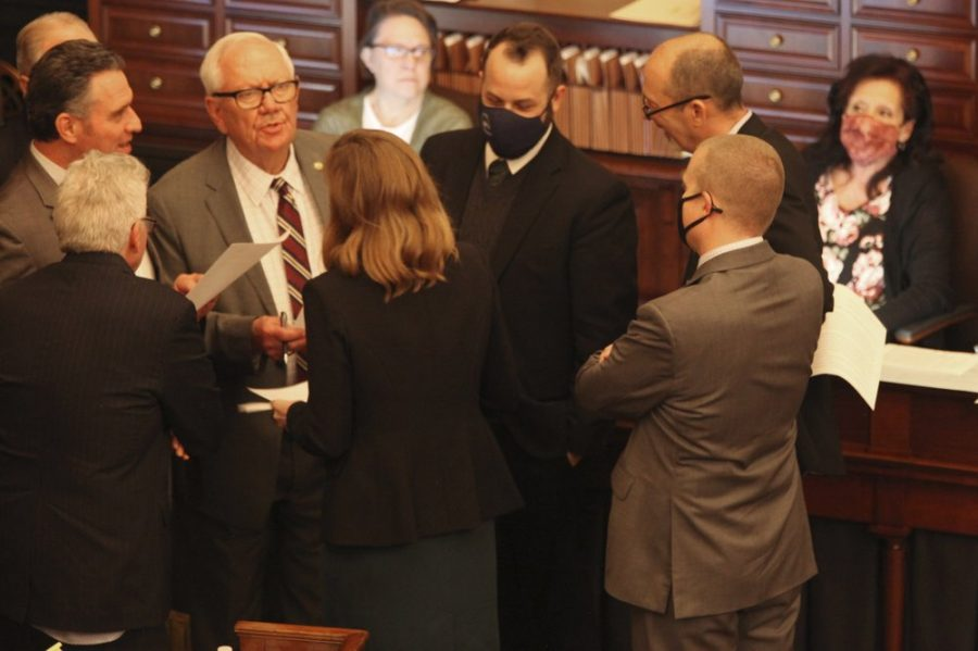 Members of the Kansas Senate's Rules Committee confer during a debate on a bill that would ban transgender students from girls' and women's school sports at the Statehouse, Wednesday, March 17, 2021, in Topeka, Kan.