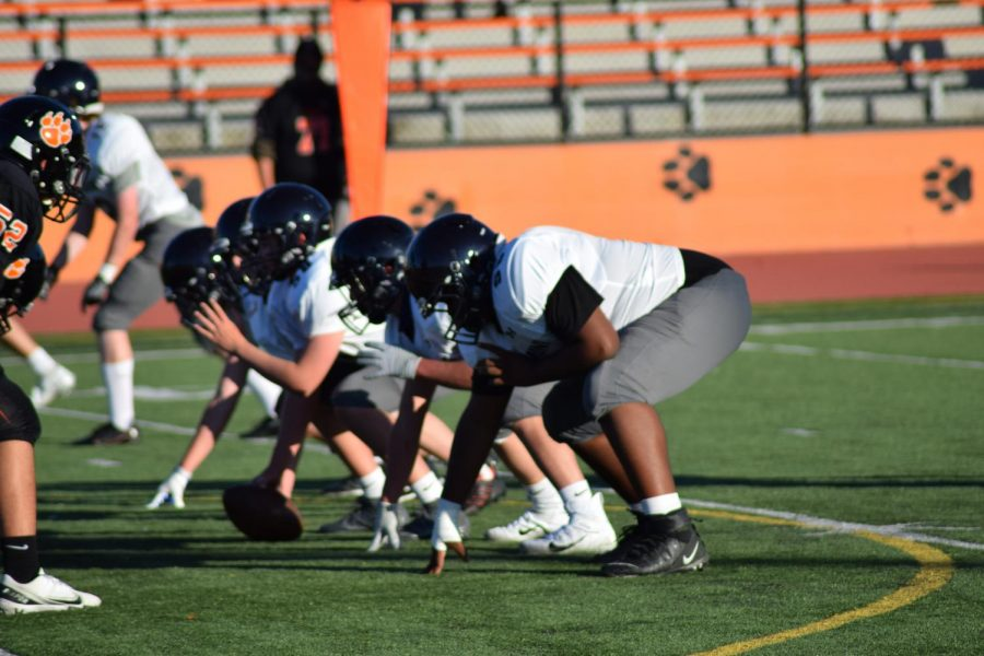 The Scots' offensive line prepares to hike the ball.