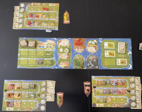 In The River, players place workers at various locations to add tiles to their river, collect resources, and complete buildings.