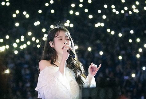 "Famed South Korean singer-songwriter IU returns with her fifth studio album, ""Lilac,"" as a farewell to her twenties."