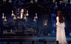 Christine (Sierra Boggess) is led beneath the opera house, to the lair of the dreaded Phantom of the Opera (Ramin Karimloo).