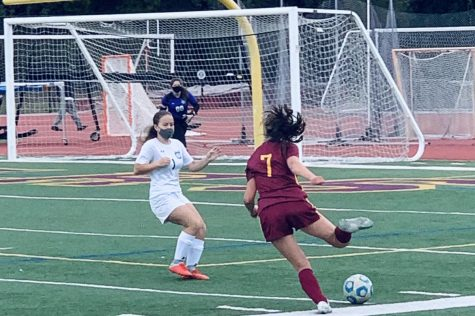 A Menlo-Atherton attacker drives the ball up the field to potentially find an open shot opportunity.