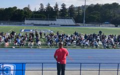 Inspirational speaker Keith Hawkins shares his message with students on the football field.