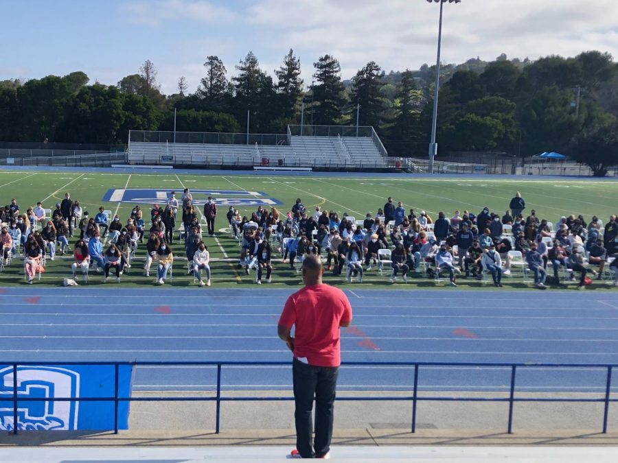 Inspirational+speaker+Keith+Hawkins+shares+his+message+with+students+on+the+football+field.