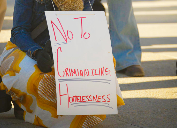 Protesters+gather+to+rally+against+a+law+that+unfairly+targets+the+homeless+population.+Photo+edited+by+Chelsea+Chang.