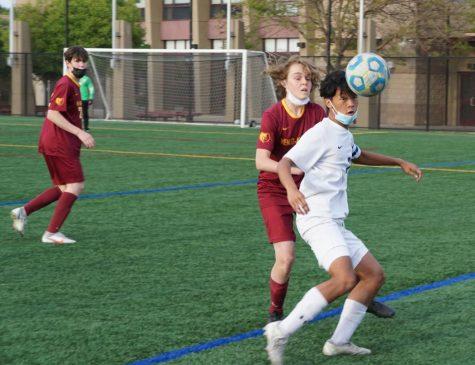 Ryan Jocson, a sophomore team captain, battles for possession.