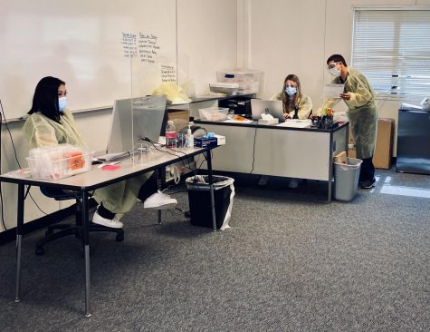 Health personnel operate Carlmonts on-campus COVID-19 testing area.